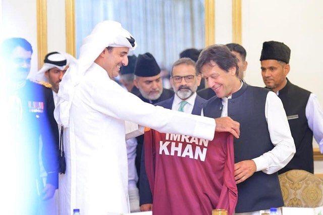 Amir of Qatar presents a sports jersey to PM Khan