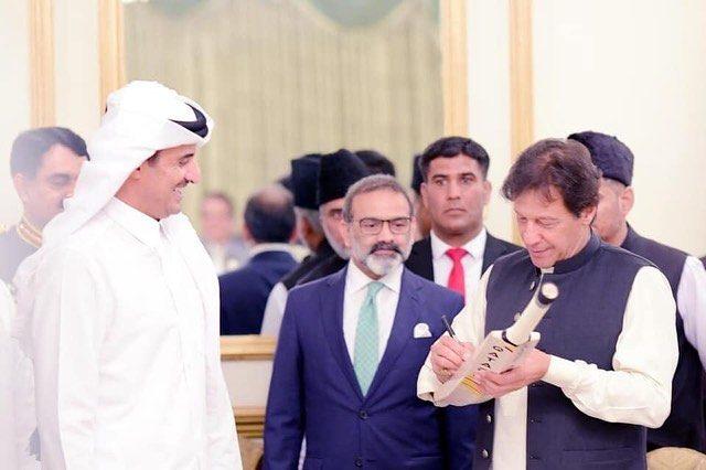 M Khan signed a cricket bat