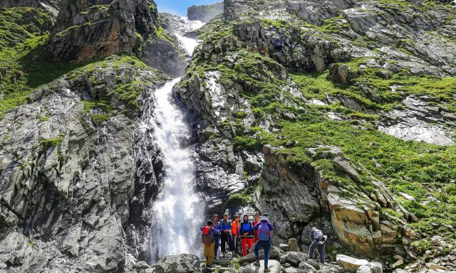Tourists-pose-for-photos-in-front-of-Mastij-waterfall.