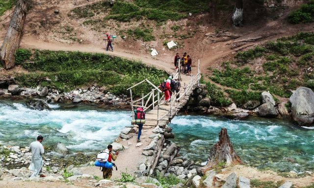A stunning view of blue water river in Anakar valley, the starting point of the trek to Mastij Lake.