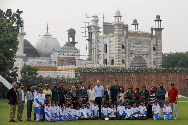 Prince William and Kate Middleton play cricket with kids