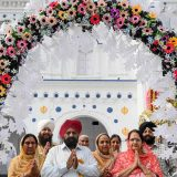 Sikh pilgrims pray as they take part in a ritual procession at a shrine in Nankana Sahib, some 75 kms west of Lahore on November 7, 2019, on the occasion of the 550th birth anniversary of Guru Nanak Dev. - A corridor that will allow Sikhs to cross from India into Pakistan to visit one of the religion's holiest sites is set to open on November 9, with thousands expected to make a pilgrimage interrupted by decades of conflict. (Photo by Arif ALI / AFP)