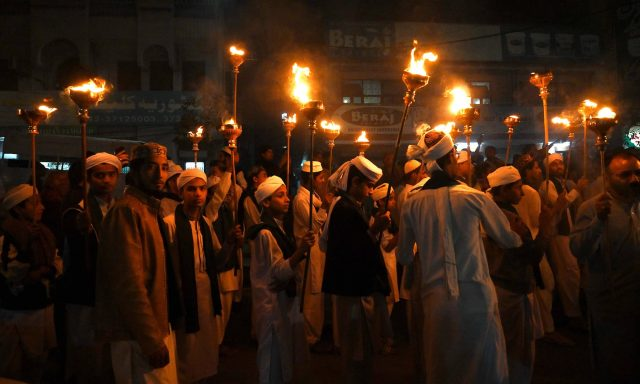 Children-hold-torches-in-a-rally-to-mark-12-Rabi-ul-Awwal-in-Lahore