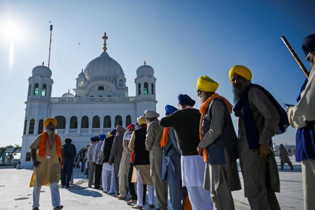 Sikh Pilgrims stand in a queue to visit the Shrine of Baba Guru Nanak Dev at Gurdwara Darbar Sahib in Kartarpur