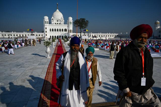 Sikh pilgrims arrive to visit the Shrine of Baba Guru Nanak Dev at Gurdwara Darbar Sahib in Kartarpur,