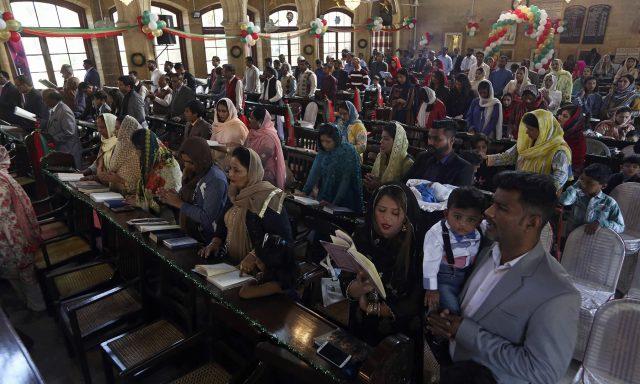 Christians attend Christmas Mass at a church in Karachi,