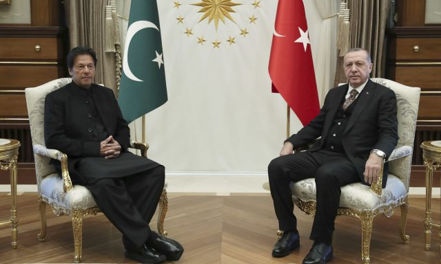 Turkey's President Recep Tayyip Erdogan, right, and Pakistan's Prime Minister Imran Khan pose for the media before a meeting, in Ankara, Turkey, Friday, Jan. 4, 2019. The two expected to discuss bilateral and regional issues.