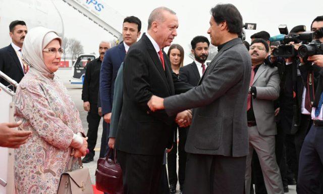 Pakistan's Prime Minister Imran Khan receives Turkish President Tayyip Erdogan on his arrival in Islamabad