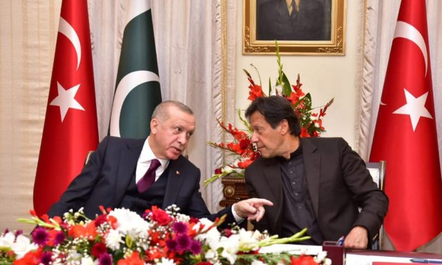 Pakistan's Prime Minister Imran Khan and Turkish President Tayyip Erdogan share light moment during an agreement signing ceremony in Islamabad