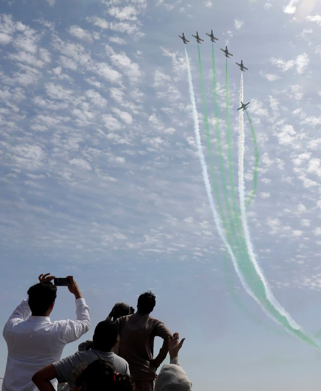 Pakistan Air Force jets perform to commemorate Pakistan Air Force's 'Operation Swift Retort', during an air show in Karachi