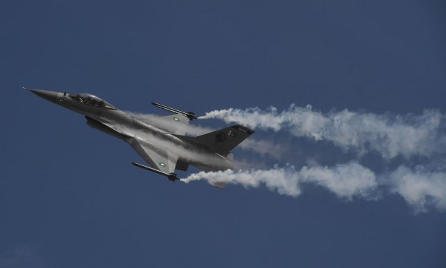 A Pakistani fighter jet F-16 flies over Karachi
