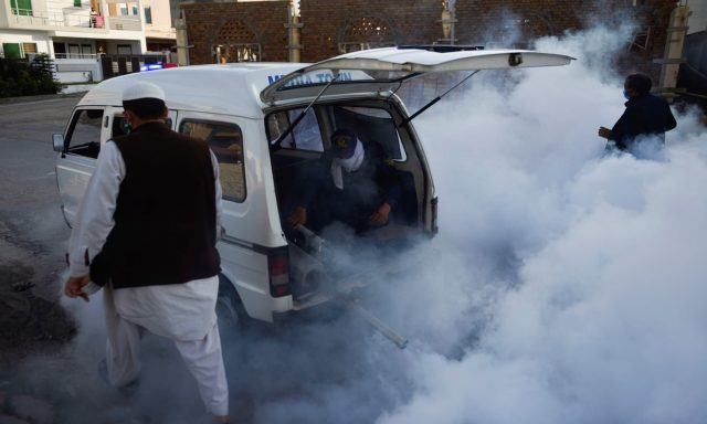 -Workers-fumigate-in-a-residential-area-in-Rawalpind.j
