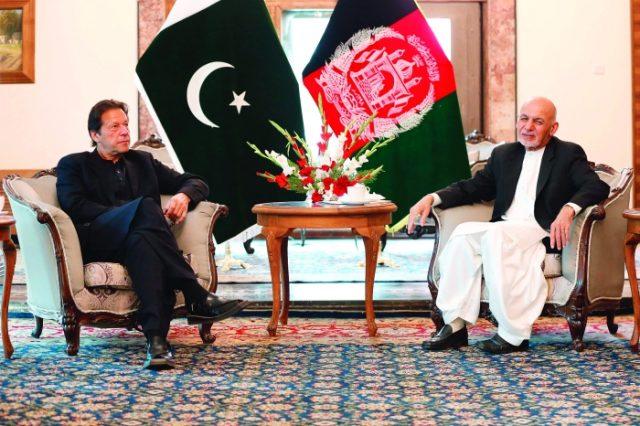 Pakistan's Prime Minister Imran Khan (left) and Afghan President Ashraf Ghani in Kabul on Thursday. (AFP)