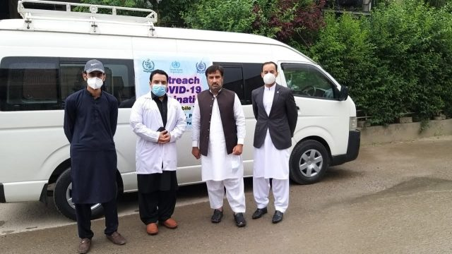 NIH mobile team facilitating Outreach COVID-19 Vaccination for elderly people