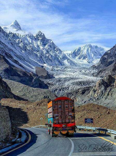 7 Pakistani Trucks and snow covered Karakoram Mountains