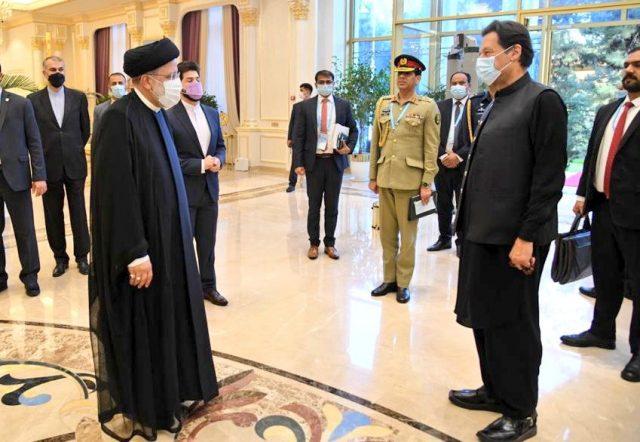11 imran khan meets H.E. Ebrahim Raisi, President of Iran at Dushanbe.